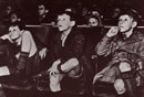 A black and white image of three boys sitting in a cinema staring in awe
